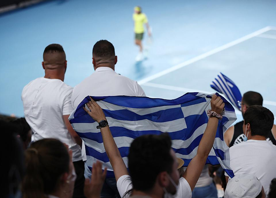 Greek fans, pictured here showing their support for Stefanos Tsitsipas.