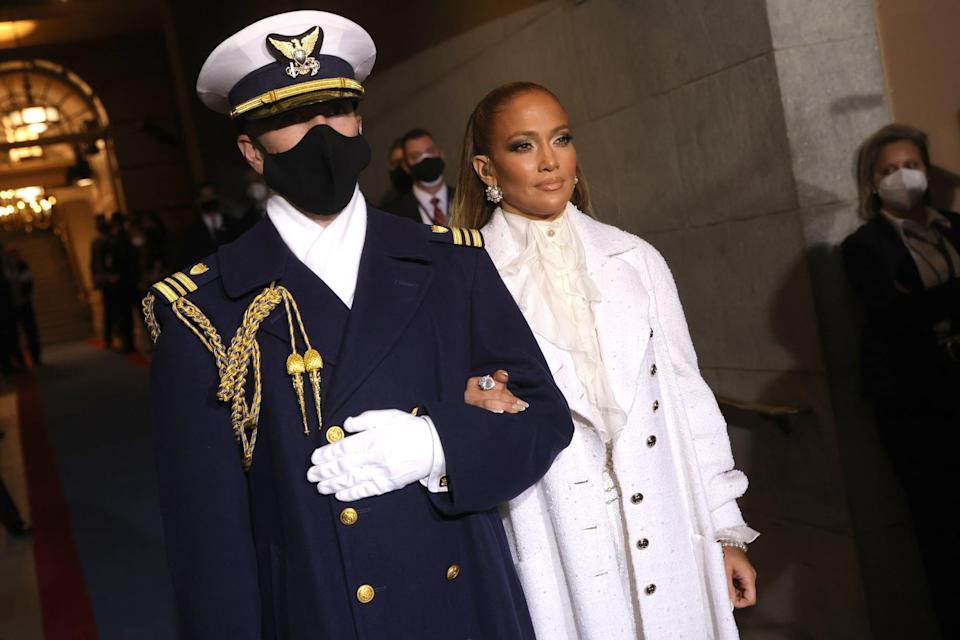 WASHINGTON, DC - JANUARY 20: Jennifer Lopez is escorted to  the inauguration of U.S. President-elect Joe Biden on the West Front of the U.S. Capitol on January 20, 2021 in Washington, DC.  During today's inauguration ceremony Joe Biden becomes the 46th president of the United States. (Photo by Win McNamee/Getty Images)