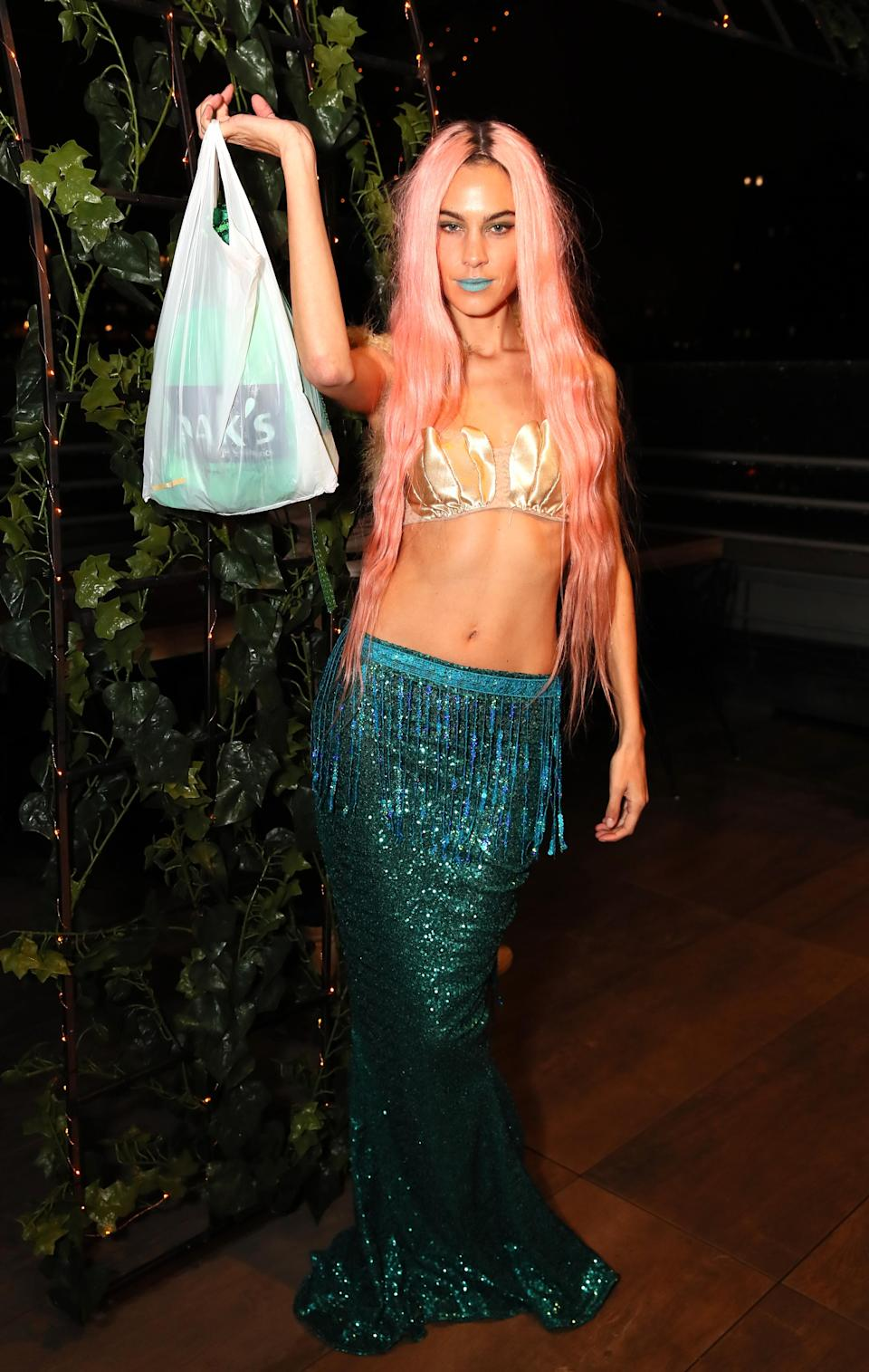 <p>Alexa Chung attended The Misshapes Halloween party in New York dressed as a mermaid. <em>[Photo: Getty]</em> </p>