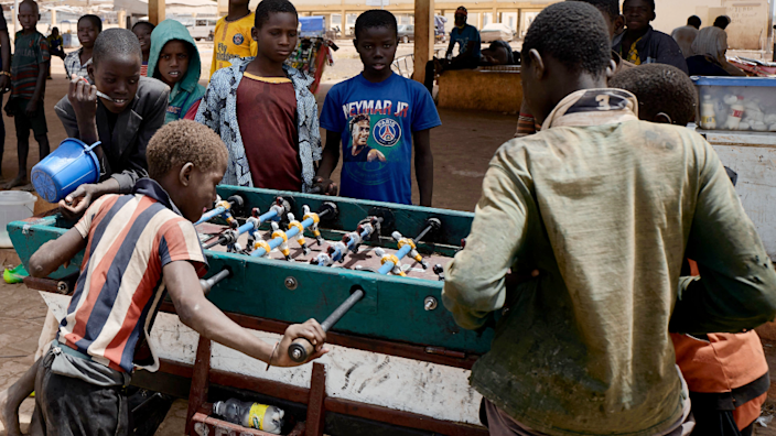 Children play at a table football in the port of Mopti, Mali - Friday 19 March 2021