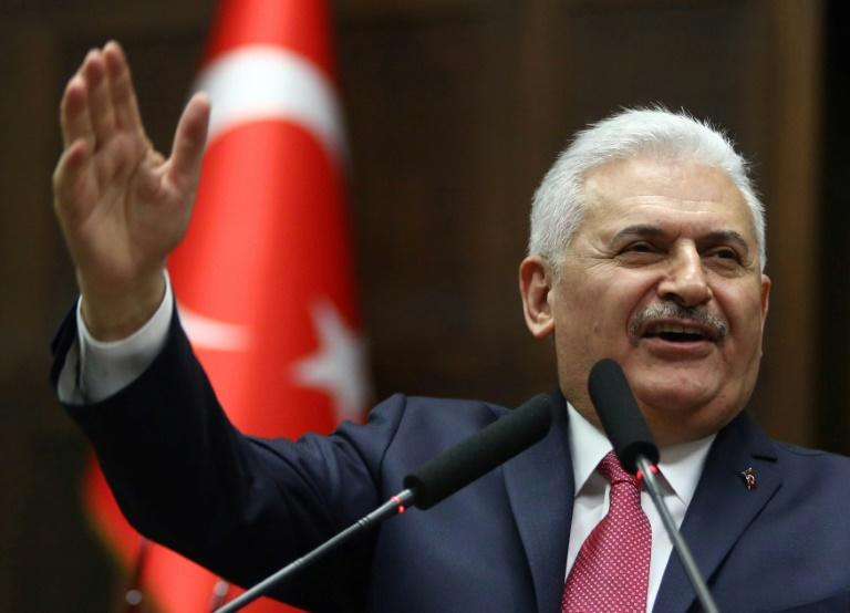 Turkish Prime Minister Binali Yildirim addresses lawmakers in Ankara, on February 28, 2017