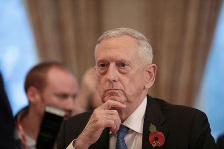 U.S. Secretary for Defense, Jim Mattis, sits opposite Britain's Secretary of State for Defence, Gavin Williamson, before a meeting at the Ministry of Defence Ministry of Defence in central London