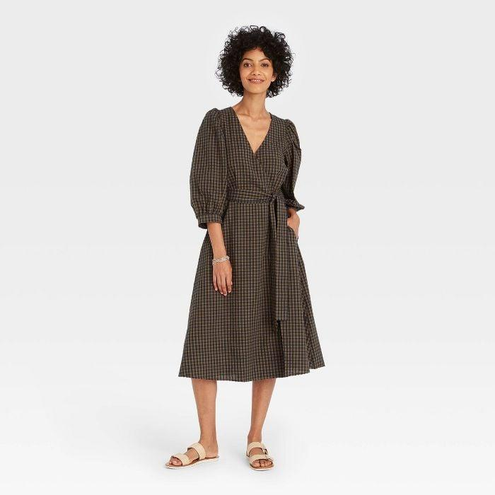 """<p>Customers, including <a href=""""https://www.popsugar.com/fashion/target-new-day-plaid-dress-review-48492065"""" class=""""link rapid-noclick-resp"""" rel=""""nofollow noopener"""" target=""""_blank"""" data-ylk=""""slk:POPSUGAR's very own editor Kelsey Mulvey"""">POPSUGAR's very own editor Kelsey Mulvey</a>,have been raving about this new <span>A New Day 3/4 Sleeve Wrap Dress</span> ($28), so it grabbed our attention. This pattern is particularly fall-friendly, but it comes in two different patterns.</p>"""