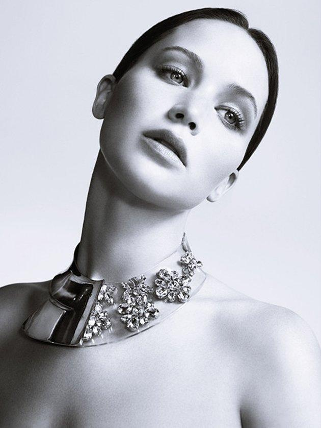 "Jennifer Lawrence's moles, freckles and beauty marks get a lot of online attention (fans have even confessed they know the placement of each one sprinkled across her face, neck and chest). So it is surprising to see them disappear entirely in her new campaign for Miss Dior. The Oscar nominee looks stunning in the high-fashion photos, but we can't help feeling like something is missing. ""She has tons of birthmarks all over her neck but in these photos they were all erased,"" said one commenter, while others are complaining that the images are too airbrushed and look ""nothing like the actress,"" saying ""she is a pretty, healthy girl that they turned into someone overly thin…and pretty much unrecognizable. Look at those tiny arms."""