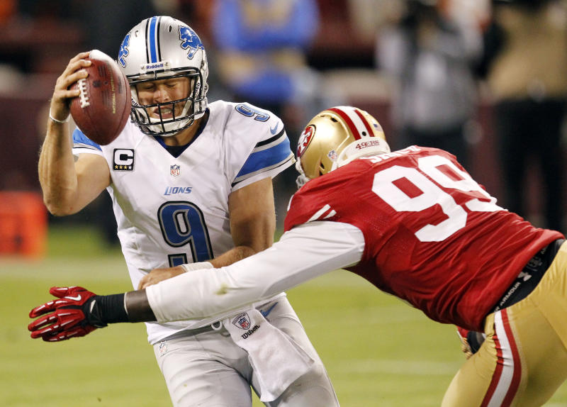 Detroit Lions quarterback Matthew Stafford (9) is sacked by San Francisco 49ers outside linebacker Aldon Smith (99) during the fourth quarter of an NFL football game in San Francisco, Sunday, Sept. 16, 2012. San Francisco won 27-19.  (AP Photo/Tony Avelar)