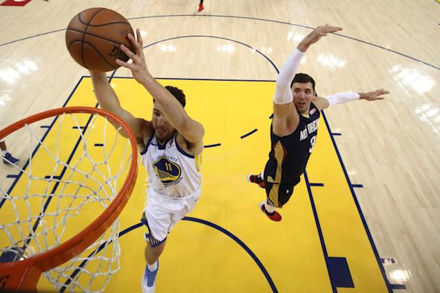 May 8, 2018; Oakland, CA, USA; Golden State Warriors guard Klay Thompson (11) dunks the basketball against New Orleans Pelicans forward Nikola Mirotic (3) during the first half in game five of the second round of the 2018 NBA Playoffs at Oracle Arena. The Warriors defeated the Pelicans 113-104. Mandatory Credit: Ezra Shaw/Pool Photo via USA TODAY Sports TPX IMAGES OF THE DAY