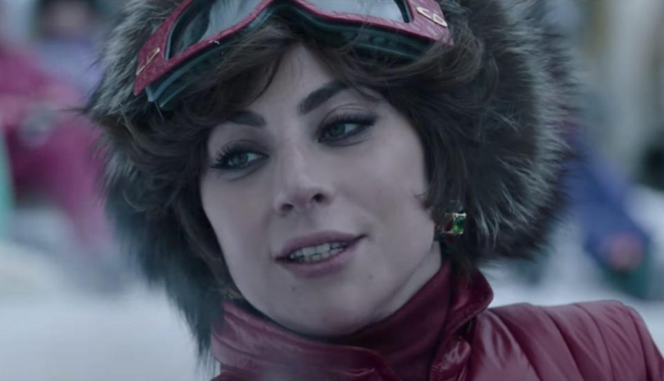 Lady Gaga in a red ski suit.