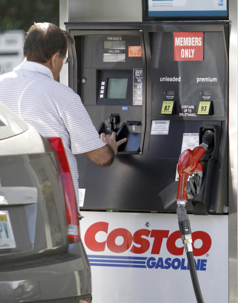In this Feb. 27, 2012 a Costco customer prepares to fuel up at a Costco gasoline station in North Miami Beach, Fla. Costco Wholesale Corp.'s fiscal second-quarter net income rose 13 percent as sales improved and it made more money from membership fees. The wholesale club operator's performance topped Wall Street's expectations. (AP Photo/Alan Diaz)