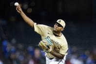 Arizona Diamondbacks starting pitcher Humberto Mejia throws against the Los Angeles Dodgers during the first inning of a baseball game Sunday, Sept. 26, 2021, in Phoenix. (AP Photo/Ross D. Franklin)