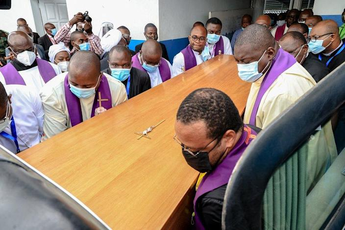 Pallbearers carry the coffin of Cardinal Christian Tumi to a hearse after mass in Douala, Cameroon.