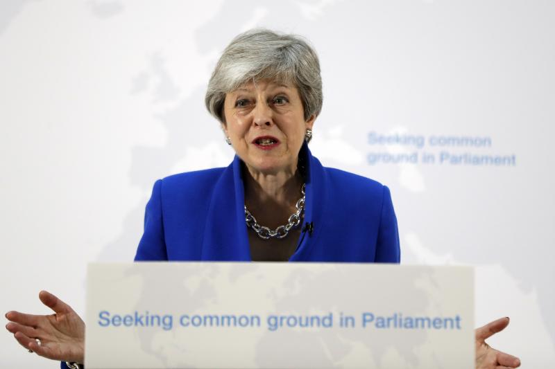 Seeking Brexit support, May offers vote on new referendum