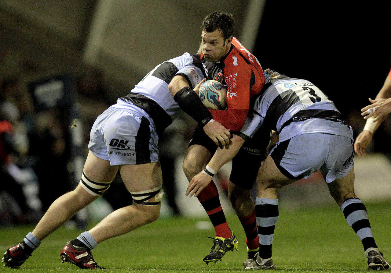 Newcastle Falcons' Andrew Van der Heijden and Euan Murray (R) tackles Toulon's Luke Rooney (2R) during a pool 2, European Challenge Cup rugby union match at Kingston Park, Newcastle upon Tyne, England, on December 08, 2011. AFP PHOTO/GRAHAM STUART (Photo credit should read GRAHAM STUART/AFP/Getty Images)