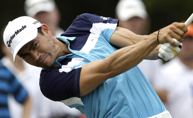 Camilo Villegas, of Colombia, hits a tee shot on the 16th hole during the final round of the Wyndham Championship golf tournament in Greensboro, N.C., Sunday, Aug. 17, 2014. Villegas won the tournament with a 17 under-par 263. (AP Photo/Gerry Broome)