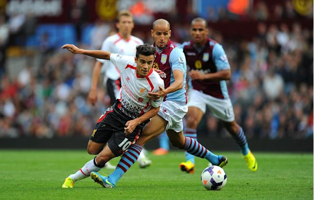 BIRMINGHAM, ENGLAND - AUGUST 24: Liverpool player Phillipe Coutinho (l) is challenged by Karim El Ahmadi during the Barclays Premier League match between Aston Villa and Liverpool at Villa Park on August 24, 2013 in Birmingham, England. (Photo by Stu Forster/Getty Images)