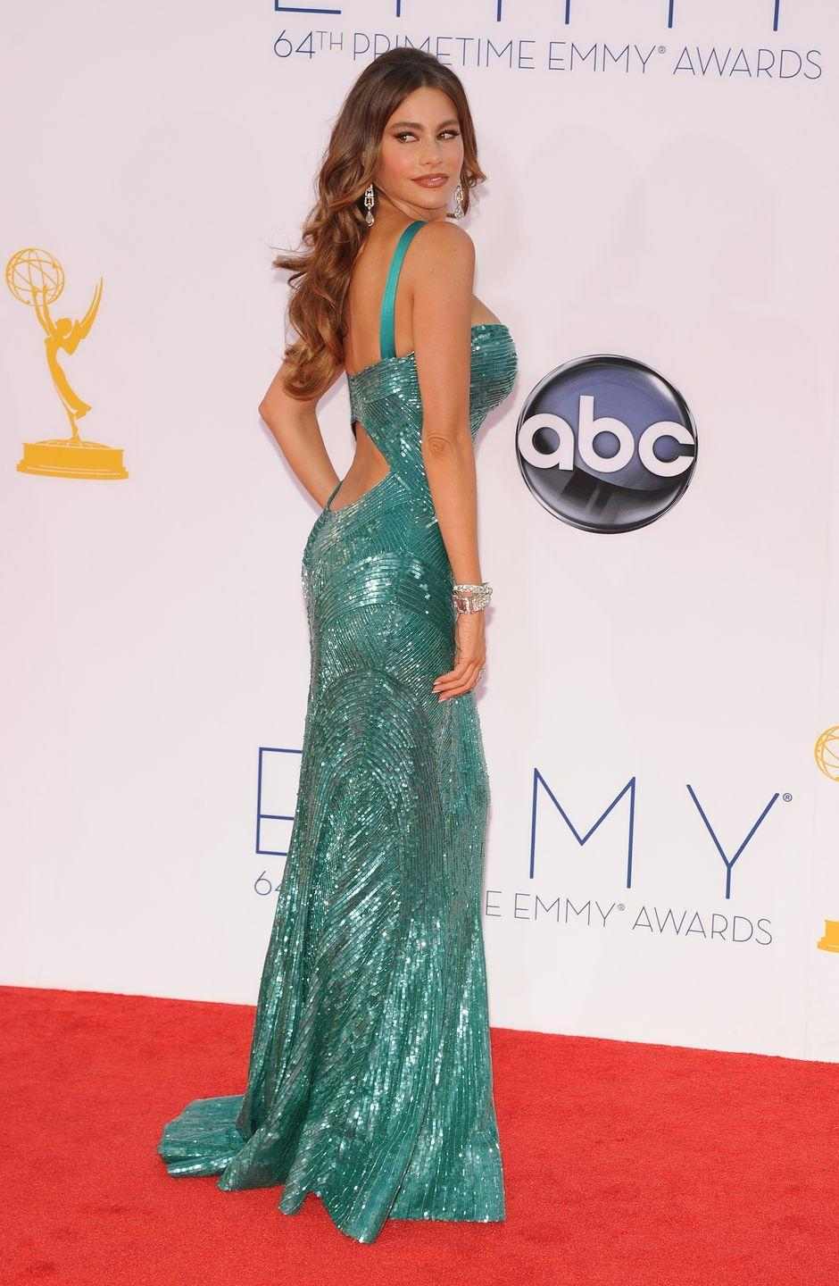 "<p>This teal sequin number with its back cutout and plunging neckline was definitely a showstopper. The dress ended up ripping down the back in a <a href=""https://www.thedailybeast.com/sofia-vergaras-wardrobe-malfunction-at-the-emmys-didnt-slow-her-down"" rel=""nofollow noopener"" target=""_blank"" data-ylk=""slk:hilarious wardrobe malfunction"" class=""link rapid-noclick-resp"">hilarious wardrobe malfunction</a>, but was thankfully fixed right before she went up on stage with the rest of her <em>Modern Family </em>co-stars. </p>"