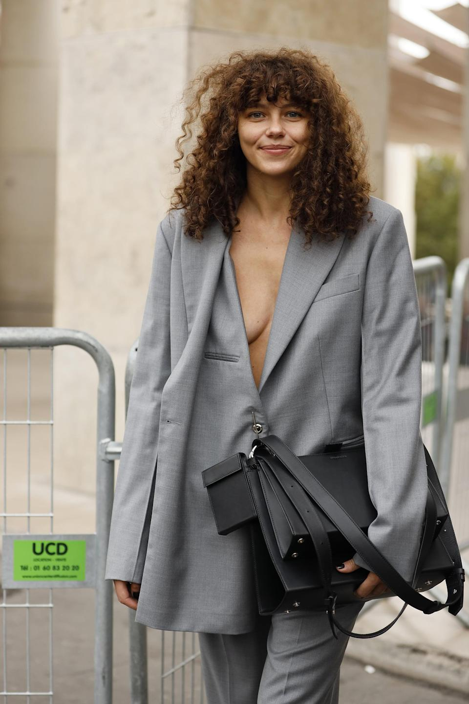 <p>Bangs look great on <em>any</em> hair type - and this is especially true with curls. The only difference is how your stylist cuts them. No matter your curl pattern, most hairstylists will leave the hair a little longer across the forehead to account for any shrinkage.</p>
