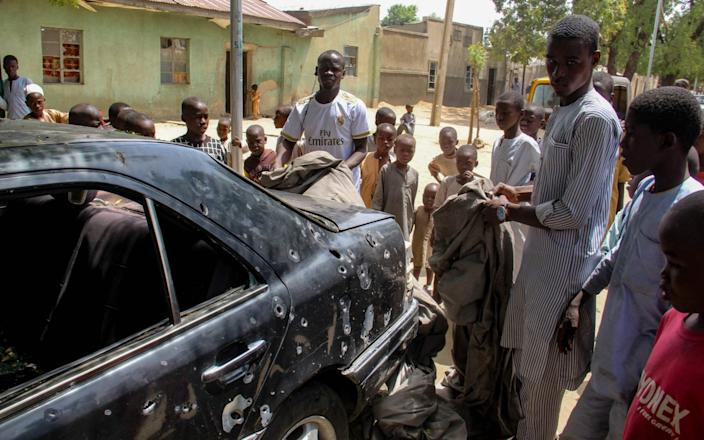 The wreckage of a car hit by an attack led by Boko Haram