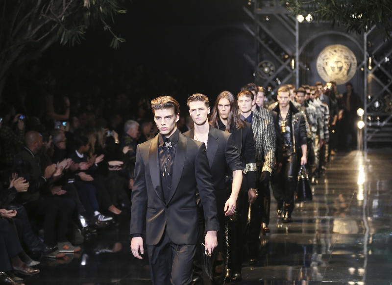 Models wear creations for Versace men's Autumn-Winter 2014 collection, part of the Milan Fashion Week, unveiled in Milan, Italy, Saturday, Jan. 11, 2014. (AP Photo/Antonio Calanni)