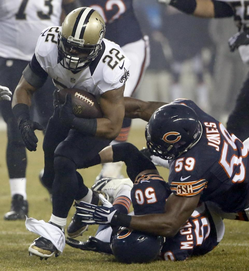 New Orleans Saints running back Mark Ingram (22) carries the ball against Chicago Bears outside linebacker Shea McClellin (50) and inside linebacker Christian Jones (59) during the first half of an NFL football game Monday, Dec. 15, 2014, in Chicago. (AP Photo/Charles Rex Arbogast)