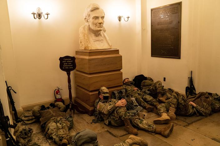 Members of the National Guard sleep in the halls of the Capitol on Wednesday, January 13, 2021. / Credit: Kent Nishimura / Los Angeles Times via Getty Images