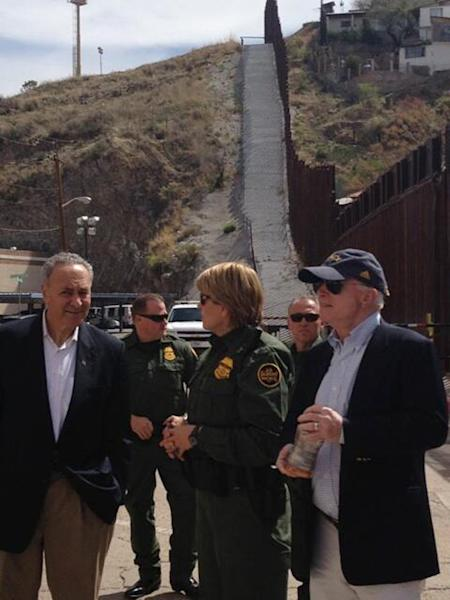 In this photo posted to the Twitter account of U.S. Sen. John McCain, R-Ariz., McCain, right, and U.S. Sen. Charles Schumer, D-N.Y., left, stand with U.S. Border Patrol agents during a tour of the Mexico border with the United States on Wednesday, March 27, 2013, in Nogales, Ariz. The senators are part of a larger group of legislators shaping and negotiating details of an immigration reform package vowed Wednesday to make the legislation public when Congress reconvenes next month. McCain tweeted that he witnessed a woman successfully climb the 18-foot fence during the visit. (AP Photo/Office of Sen. John McCain)