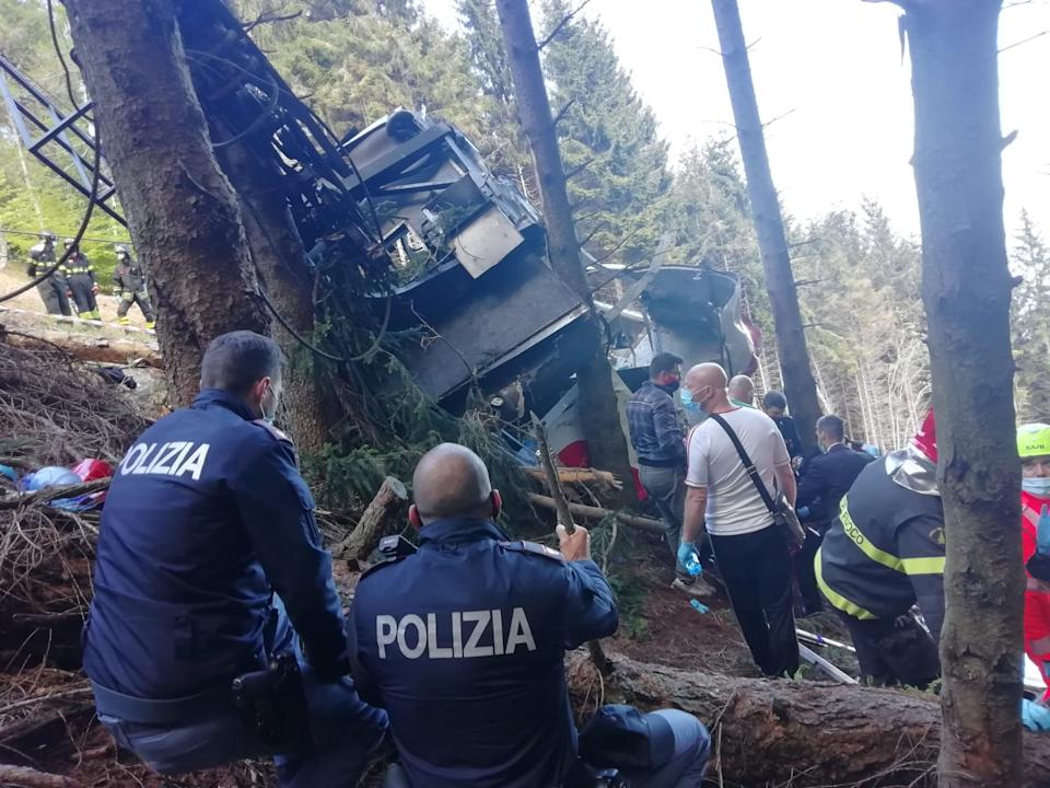 Police and rescue service members are seen near the crashed cable car after it collapsed in Stresa, near Lake Maggiore, Italy May 23, 2021. ITALIAN POLICE/Handout via REUTERS THIS IMAGE HAS BEEN SUPPLIED BY A THIRD PARTY.