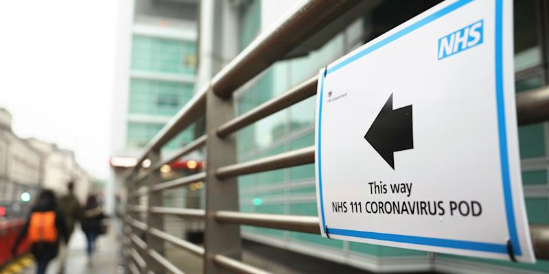 A sign directs directs patients to an NHS 111 Coronavirus Pod testing service area for COVID 19 assessment at University College Hospital in London on March 5, 2020. ISABEL INFANTES:AFP via Getty Images)