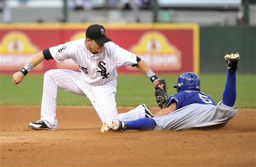 Chicago White Sox second baseman Gordon Beckham, left, tags out Texas Rangers' Ian Kinsler as Kinsler tries to steal second base during the fourth inning of a baseball game, Wednesday, July 4, 2012 in Chicago. (AP Photo/Brian Kersey)