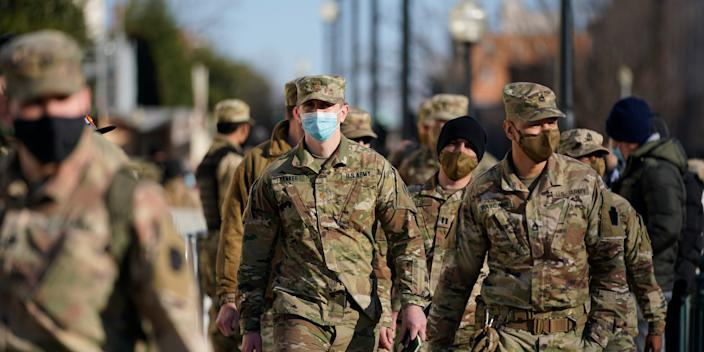 DC National Guard walk around the Capitol grounds, Thursday morning, Jan. 7, 2021 in Washington