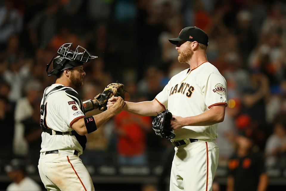 SAN FRANCISCO, CALIFORNIA - JUNE 11: Catcher Stephen Vogt #21 of the San Francisco Giants celebrates with closing pitcher Will Smith #13 after a win against the San Diego Padres at Oracle Park on June 11, 2019 in San Francisco, California. (Photo by Lachlan Cunningham/Getty Images)