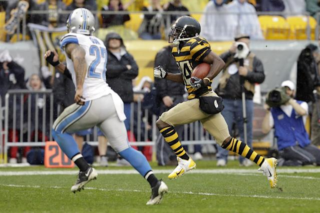 Pittsburgh Steelers wide receiver Antonio Brown (84), right, runs towards the end zone as Detroit Lions strong safety Glover Quin (27) chases after him in the first quarter of an NFL football game in Pittsburgh, Sunday, Nov. 17, 2013. (AP Photo/Gene J. Puskar)