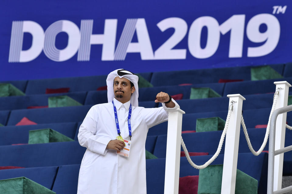An official waits for the start of competitions at the World Athletics Championships Friday, Sept. 27, 2019, in Doha, Qatar. (AP Photo/Martin Meissner)