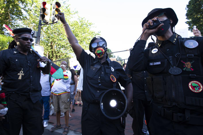 Demonstrators wearing logos of the New Black Panther Party speak during a protest at Lafayette Square near the White House, against police brutality and racism, on June 7, 2020 in Washington, DC. (Jose Luis Magana/AFP via Getty Images)