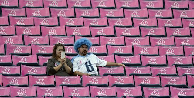 Tennessee Titans fans sit among breast cancer awareness posters before an NFL football game between the Titans and the Kansas City Chiefs on Sunday, Oct. 6, 2013, in Nashville, Tenn. (AP Photo/Mark Zaleski)