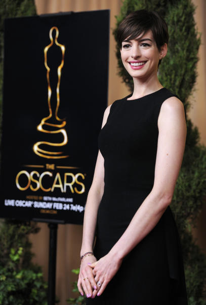 """Anne Hathaway, nominated for best actress in a supporting role for """"Les Miserables,"""" arrives at the 85th Academy Awards Nominees Luncheon at the Beverly Hilton Hotel on Monday, Feb. 4, 2013, in Beverly Hills, Calif. (Photo by Chris Pizzello/Invision/AP)"""