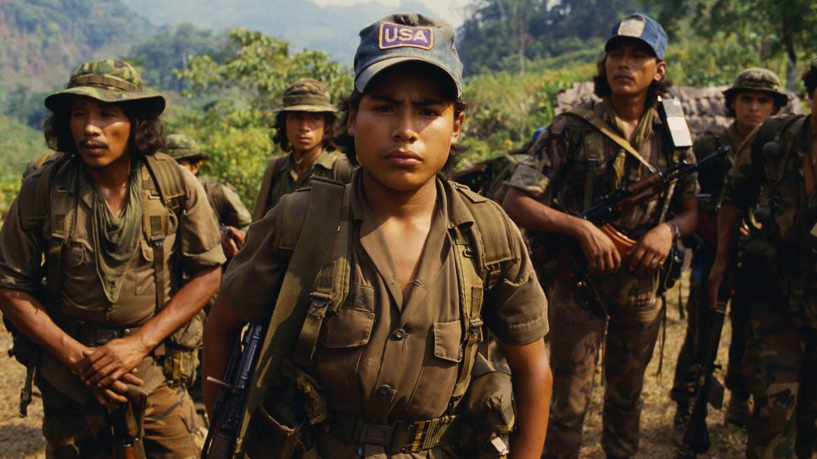 """<div class=""""inline-image__caption""""> <p>Contra rebels patrolling the northern mountains of Nicaragua. One soldier wears a 'USA' baseball hat, representing the country that aids their anti-Sandinista struggle.</p> </div> <div class=""""inline-image__credit""""> William Gentile/Corbis via Getty </div>"""