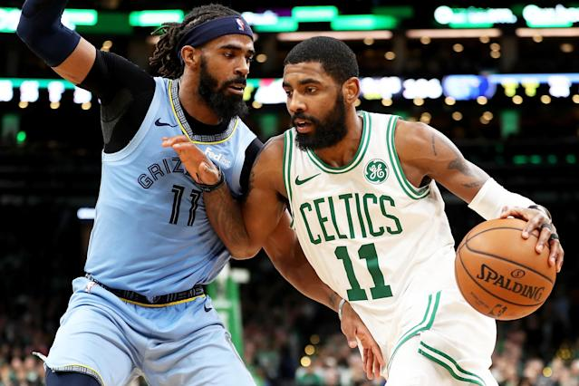 BOSTON, MA - JANUARY 18: Kyrie Irving #11 of the Boston Celtics drives to the basket past Mike Conley #11 of the Memphis Grizzlies during a game at TD Garden on January 18, 2019 in Boston, Massachusetts. (Photo by Adam Glanzman/Getty Images)