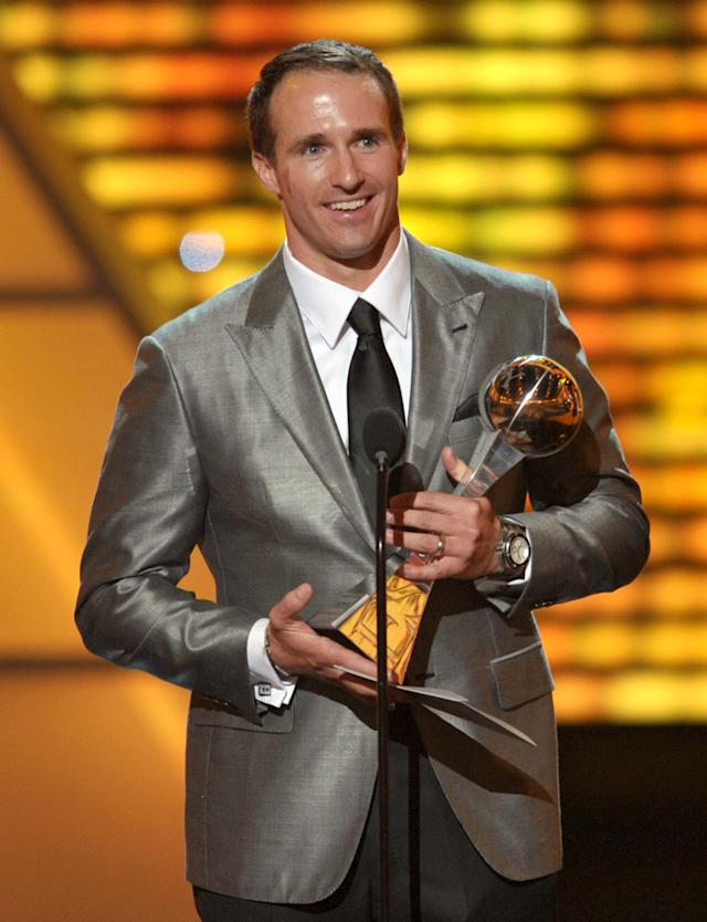 New Orleans Saints quarterback Drew Brees accepts the award for record-breaking performance at the ESPY Awards on Wednesday, July 11, 2012, in Los Angeles. (Photo by John Shearer/Invision/AP)