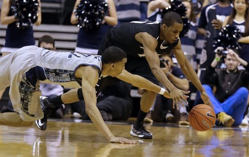 Georgetown forward Otto Porter Jr. (22) and Providence guard Bryce Cotton (11) scramble for the loose ball during the first half of an NCAA college basketball game, Wednesday, Jan. 16, 2013, in Washington. (AP Photo/Alex Brandon)