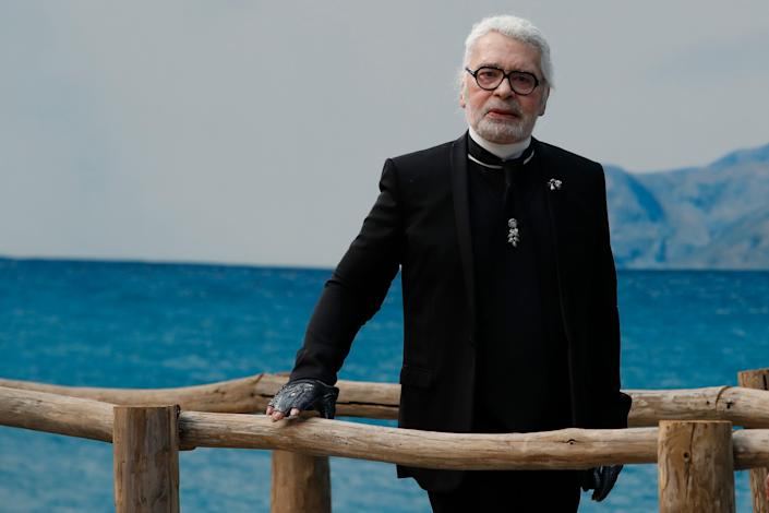 In this Tuesday, Oct.2, 2018 file photo, fashion designer Karl Lagerfeld poses after the presentation of Chanel Spring/Summer 2019 ready-to-wear fashion collection in Paris, Tuesday, Oct.2, 2018. Chanel's iconic couturier, Karl Lagerfeld, whose accomplished designs as well as trademark white ponytail, high starched collars and dark enigmatic glasses dominated high fashion for the last 50 years, has died. He was around 85 years old.