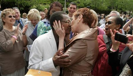 Vernita Gray and Pat Ewert kiss after their Civil Union ceremony in Chicago