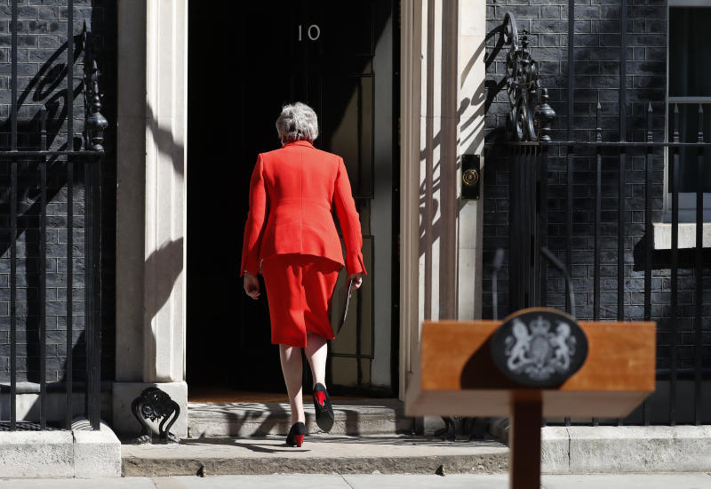 FILE - In this Friday, May 24, 2019 file photo, British Prime Minister Theresa May walks away after announcing her resignation, outside 10 Downing Street in London, England. British Prime Minister Theresa May has announced she will step down as leader of the Conservative Party on June 7, starting a process that will lead to a Conservative Party leadership contest and a new British prime minister who will lead the government during the Brexit process. (AP Photo/Alastair Grant, file)