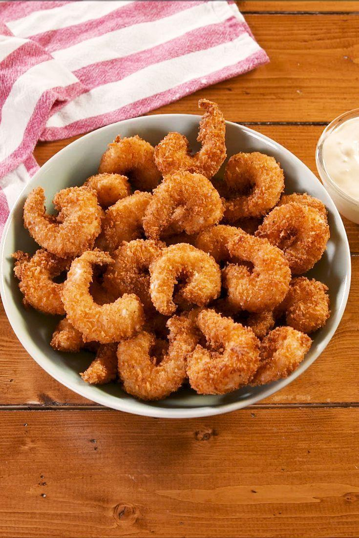 """<p>Popcorn prawns should be two things: Easy to make and easy to eat. With a homemade spicy tartare sauce, they are completely addictive and you'll want to just keep poppin' them in your mouth! </p><p>Get the <a href=""""https://www.delish.com/uk/cooking/recipes/a30166674/popcorn-shrimp-recipe/"""" rel=""""nofollow noopener"""" target=""""_blank"""" data-ylk=""""slk:Popcorn Prawns"""" class=""""link rapid-noclick-resp"""">Popcorn Prawns</a> recipe.</p>"""