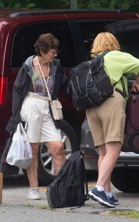 The older sister of Ghislaine Maxwell, was spotted outside a hotel close to the secluded waterfront home where Ghislaine was keeping a low profile - Credit: Richard Beetham/Splash for the Telegraph