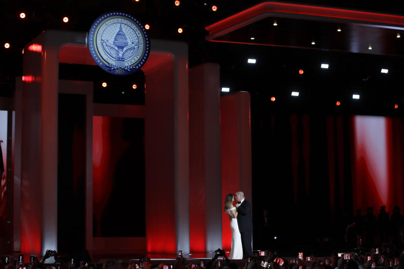 FILE- In this Jan. 20, 2017 file photo, President Donald Trump dances with first lady Melania Trump at the Liberty Ball in Washington. Big money from billionaires, corporations and a roster of NFL owners poured into Donald Trump's inaugural committee in record-shattering amounts, to pull off an event that turned out considerably lower-key than previous inaugural celebrations. (AP Photo/Patrick Semansky, File)