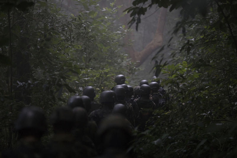 Soldiers patrol in the forest at the top of the Chapeu Mangueira slum of Rio de Janeiro, Brazil, Thursday, June 21, 2018. Almost 2000 soldiers took part in a surprise operation as part of security actions led by the Rio de Janiero military intervention. Despite that past, the military is by far the most trusted institution in Brazil today, and polls show a decline in support for democracy and increasing support for the military to take a stronger hand. (AP Photo/Leo Correa)