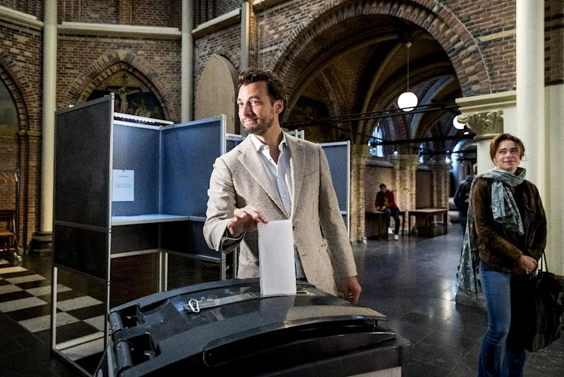 In The Netherlands, Flamboyant populist Thierry Baudet (C) is on course to beat Prime Minister Mark Rutte's Liberals (AFP Photo/Koen van Weel)