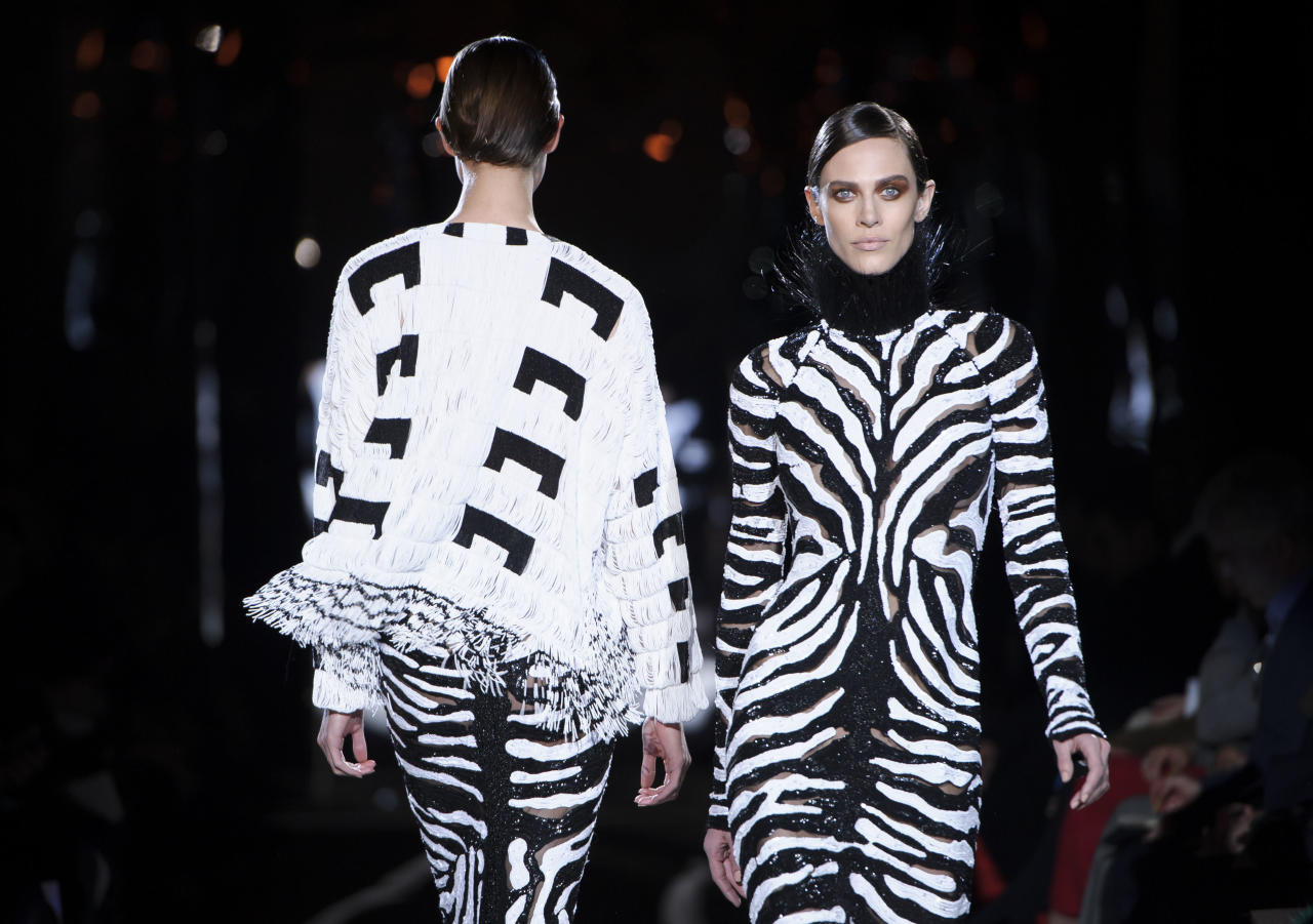 Models wear designs from the Tom Ford collection during London Fashion Week, Monday, Feb. 18, 2013, London. (Photo by Jonathan Short/Invision/AP)