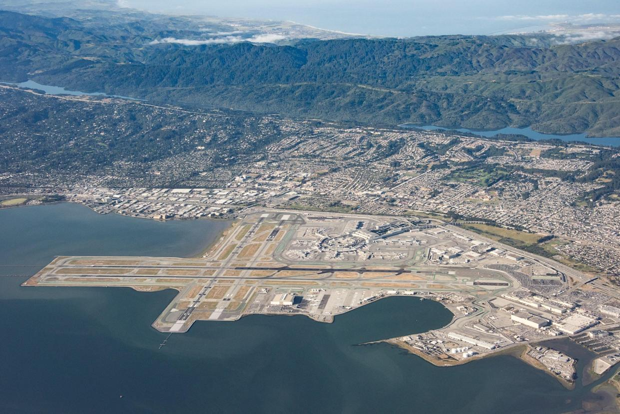 """<h1 class=""""title"""">San Francisco International Airport</h1> <div class=""""caption""""> An aerial view shows San Francisco International Airport, which is located on the water and sits less than 16 feet above sea level. </div> <cite class=""""credit"""">Photo: Getty Images/Bill Dally</cite>"""