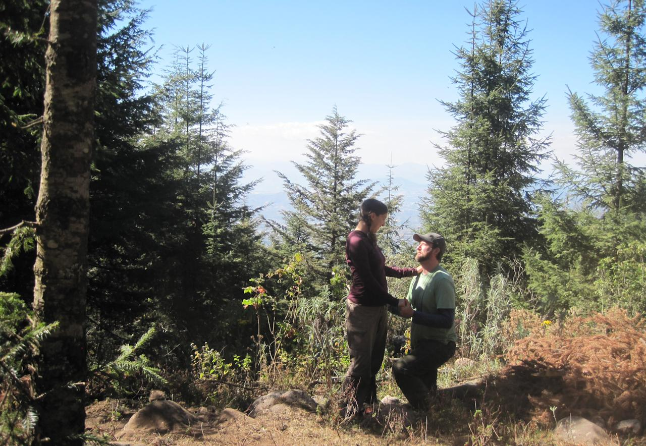 In this photo taken Feb. 14, 2013, Samantha Goldberger, left, who had just set her camera on a timer, is surprised by her boyfriend Jason Skipton, as he proposes marriage, at the El Capulin reserve, near Zitacuaro, Mexico. Skipton found the love of his life 2,000 miles from home in a chance encounter that gave him butterflies. So of course, he said, there could be no better place to propose marriage than in a swirl of orange and black butterflies that had migrated thousands of miles to mate, at the monarch butterfly sanctuary in central Mexico. (AP Photo/Samantha Goldberger)